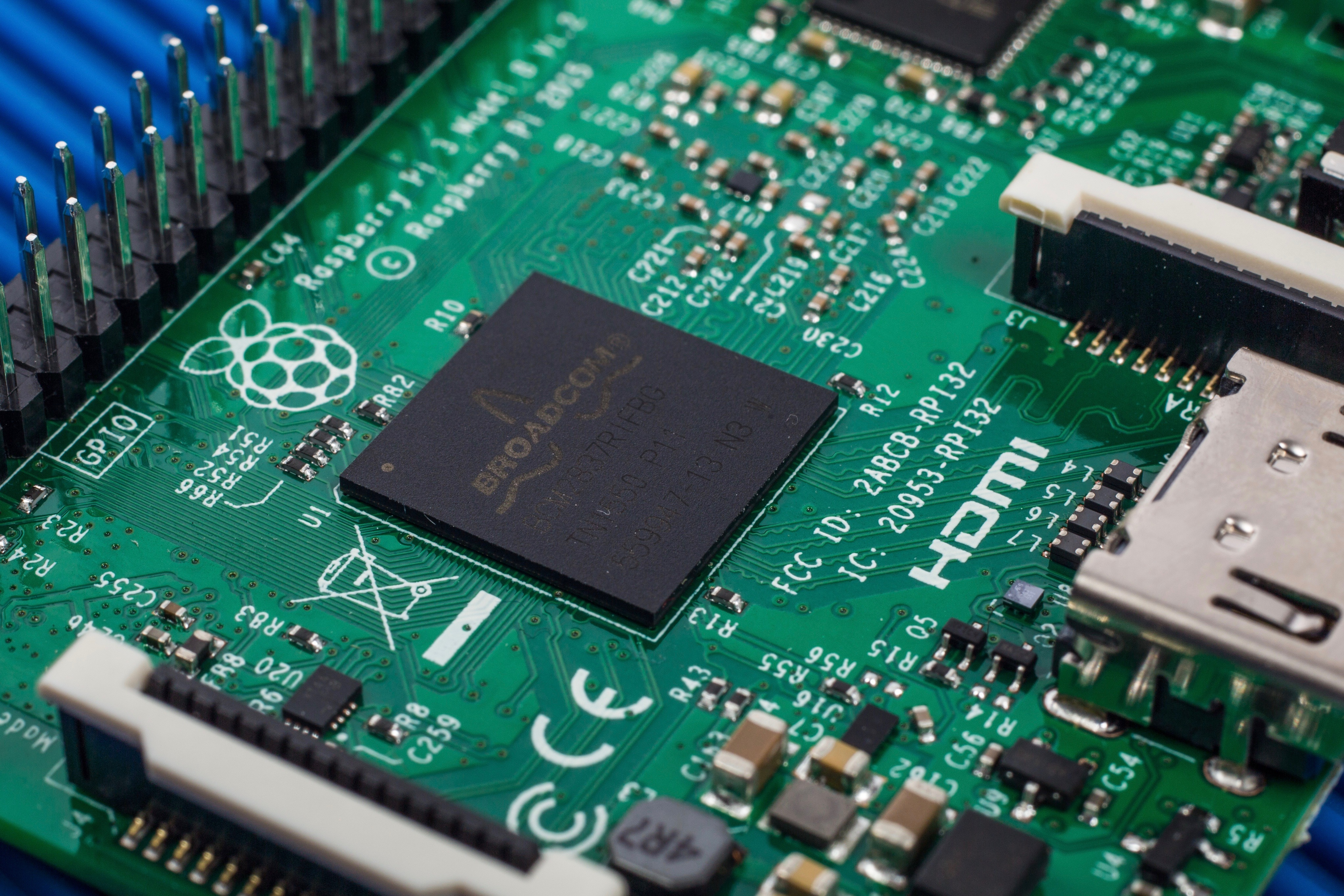 The New Raspberry Pi 3 With Wi Fi And Bluetooth Make Or Photo Of Computer Electronic Circuit Cpu Board Breaking Binary Code Bcm2837 A Quad Core 64 Bit Arm Cortex A53 Processor