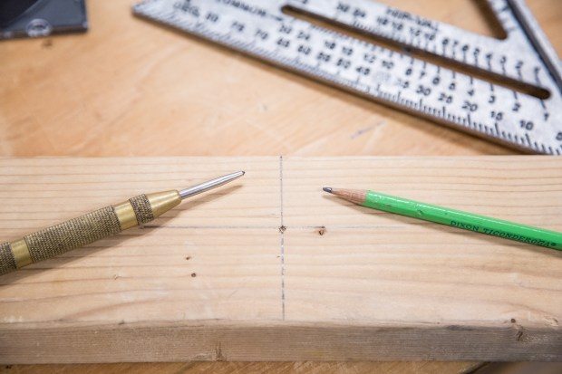 Cross measured drill hole started with center punch