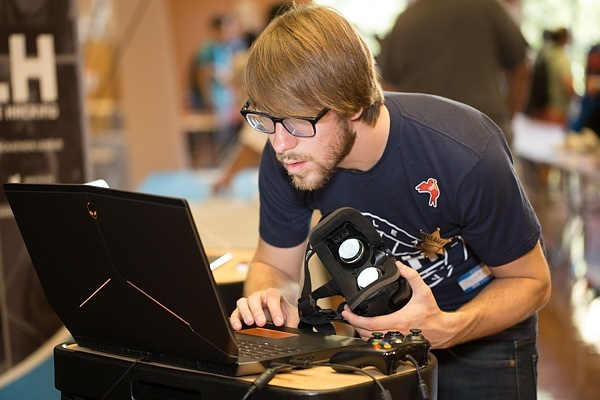 Mike Swift, CEO of Major League Hacking, tries an Oculus DK2 on an Alienware Laptop