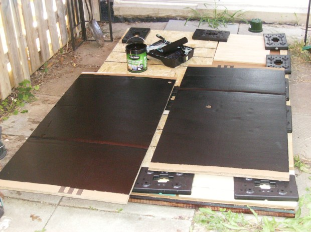 Black Liquid Rubber applied to cardboard walls of pool