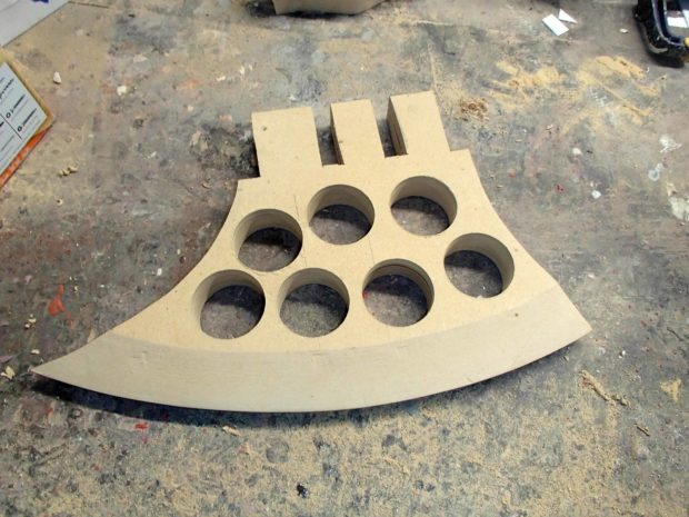 FIGURE 1-21: The hole saw quickly makes Swiss cheese out of the MDF axe blade.