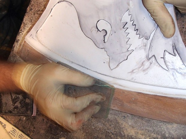 FIGURE 1-42: Smoothing the blade edge with a sanding block