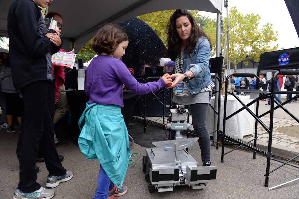 Erica Tiberia shows off her autonomous rover, an entry into one of NASA's challenges.