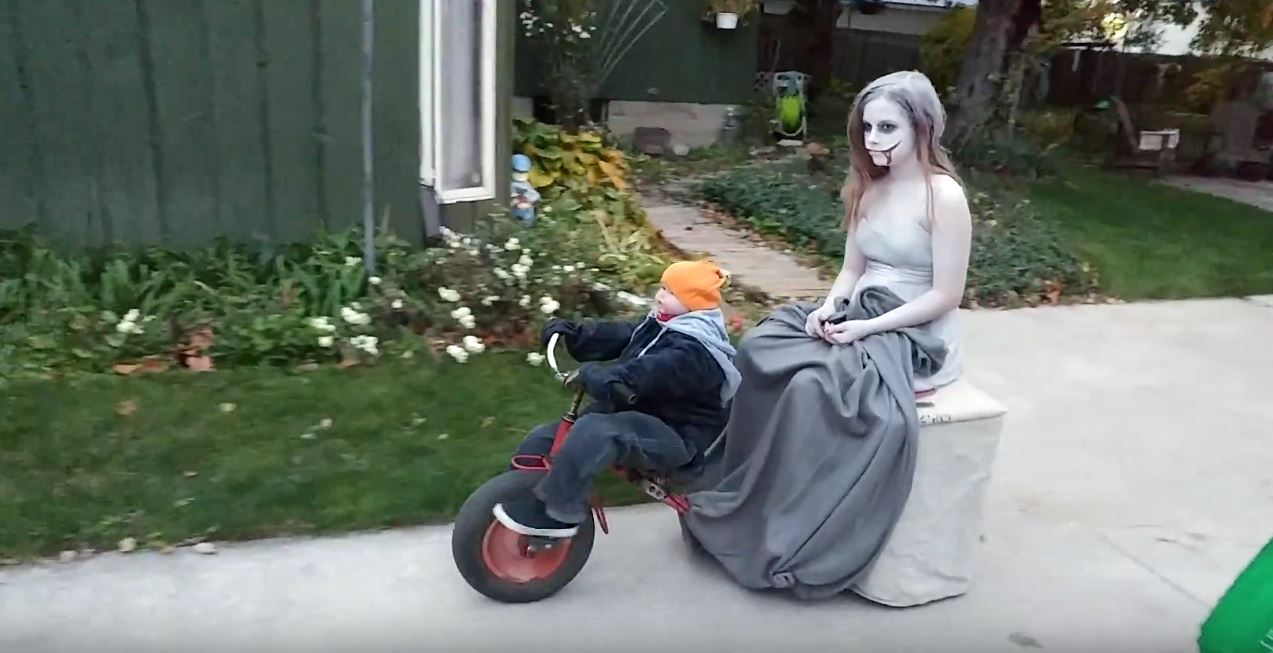 """Tricycling """"Toddler"""" Serves as Chauffeur in This Creepy Costume"""
