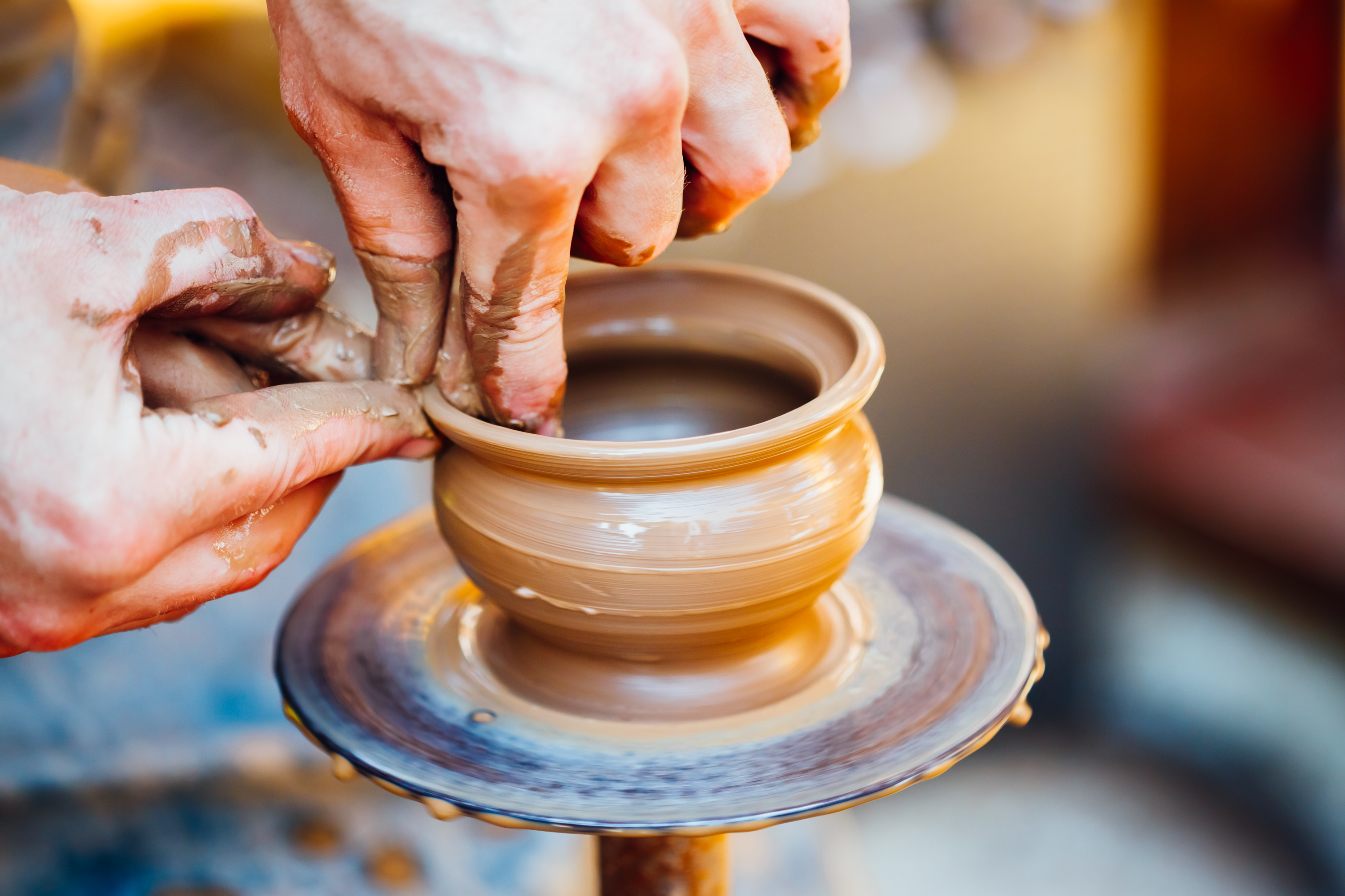 Potter using a Pottery Craft Wheel