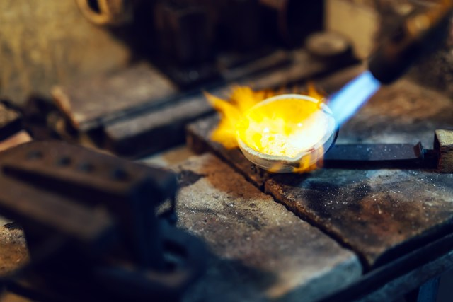 Jeweler melting gold and making jewelryJeweler melting gold and making jewelry