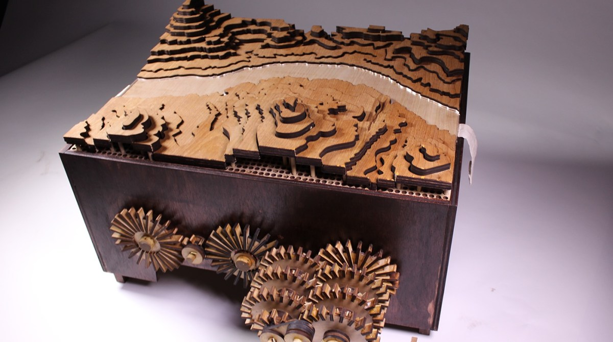 See Woodcut Topography Come to Life with the Turn of a Crank