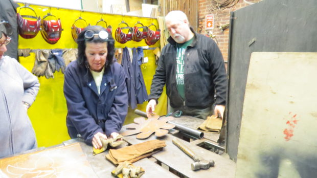 Couples Welding Class: This couple used a section of pipe to help bend their flower petal design into shape.