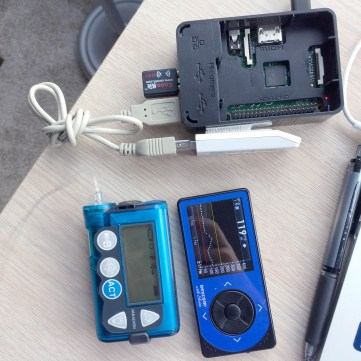 Early OpenAPS rig with an insulin pump, continuous glucose monitor, and Carelink USB stick. Photo by Dana Lewis