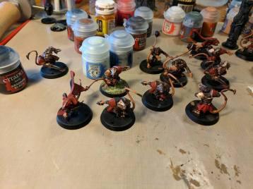 "My mutant humanoid rat men (""Skaven"") team for Blood Bowl. Each ""coach"" fields an eleven-player team. My team is the Skaven, Blake made a Goblin team."