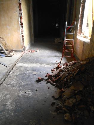 Bricks and debris in what becomes the workspace area