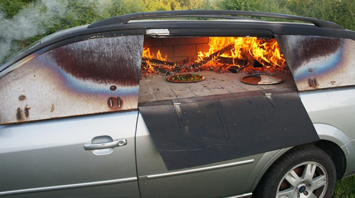 A Pizza Oven Made From An Old Car