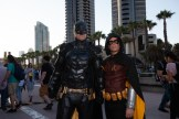 Batman and Robin stand outside.