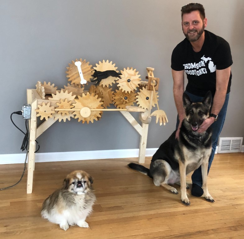 Clever Crafter Constructs Canine Caressing Contraption