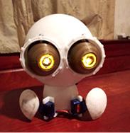 Prometheus Alien-like design with analog, animatonic moving eyeballs instead of LED matrix animation.