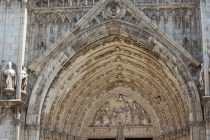 White limestone carvings over the front entrance to the Toledo Cathedral