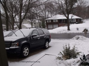 7:30 AM - a light coating on my car and the driveway