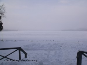 the lake early in the morning, snow blowing....