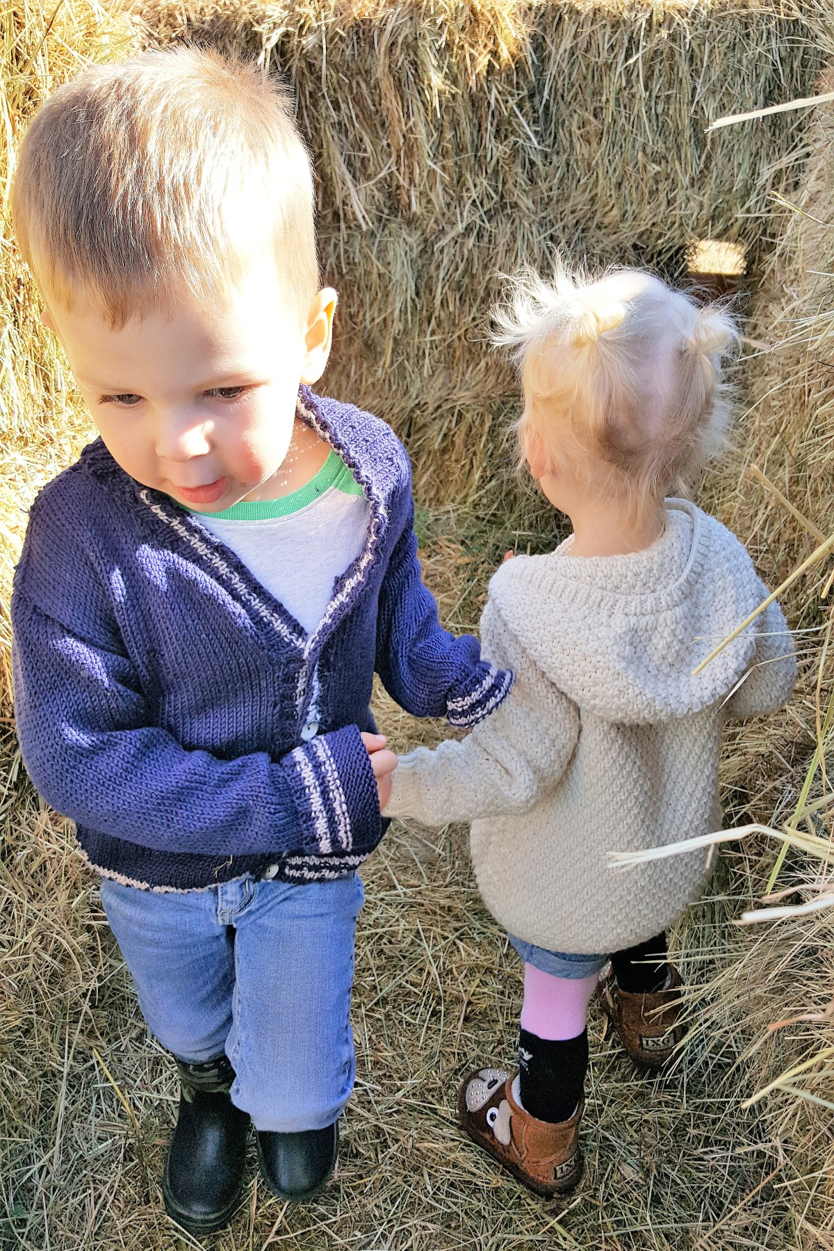 McMillan Farms Pumpkin Adventure! - holding hands in the hay maze