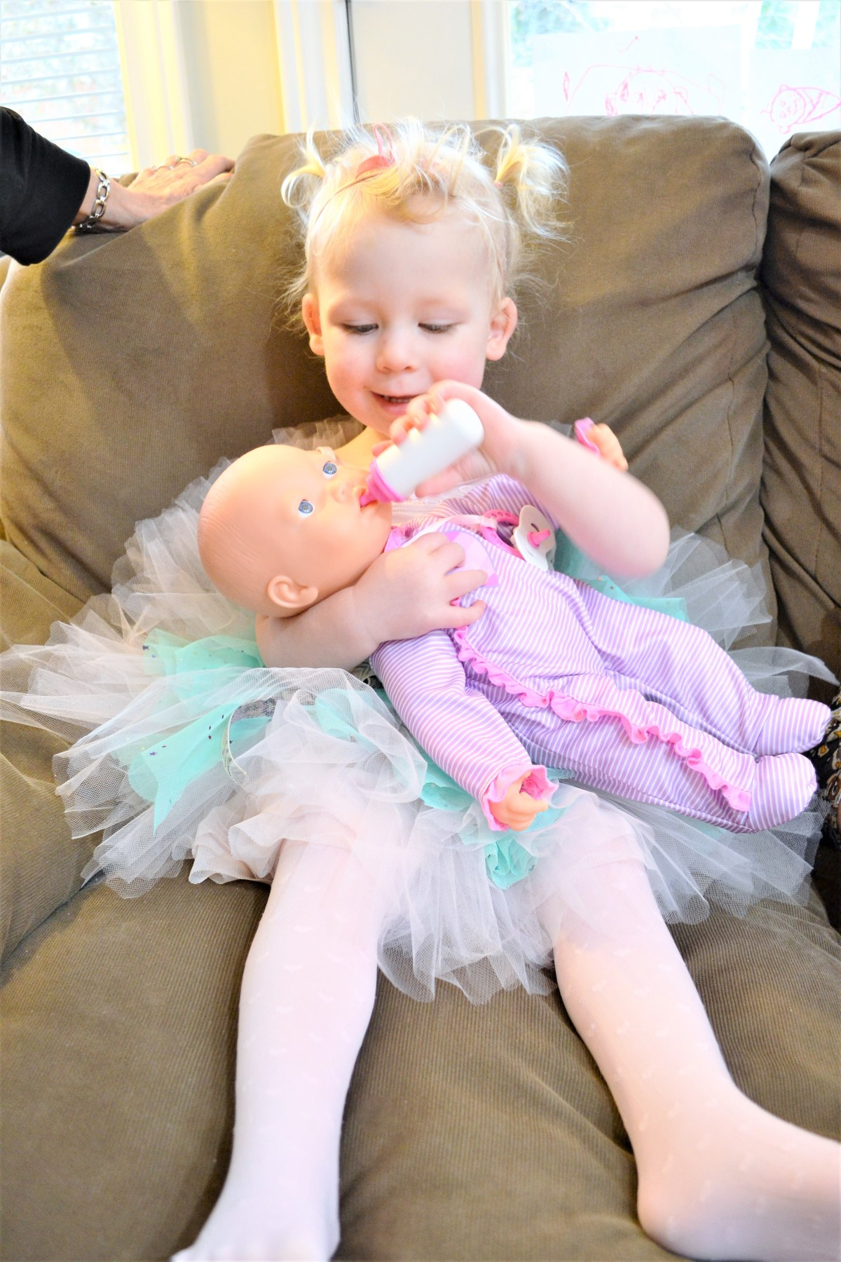 Baby Doll Party Theme - feeding the baby dolls