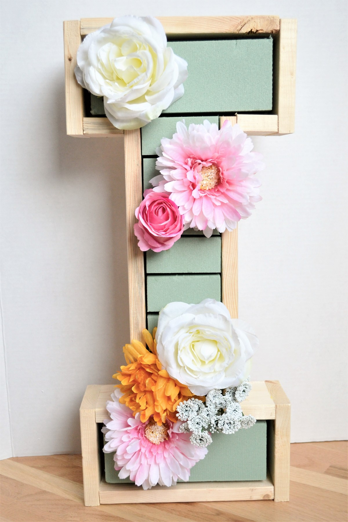 "DIY Wooden Floral Letter ""I"" Tutorial - insert flowers into foam"