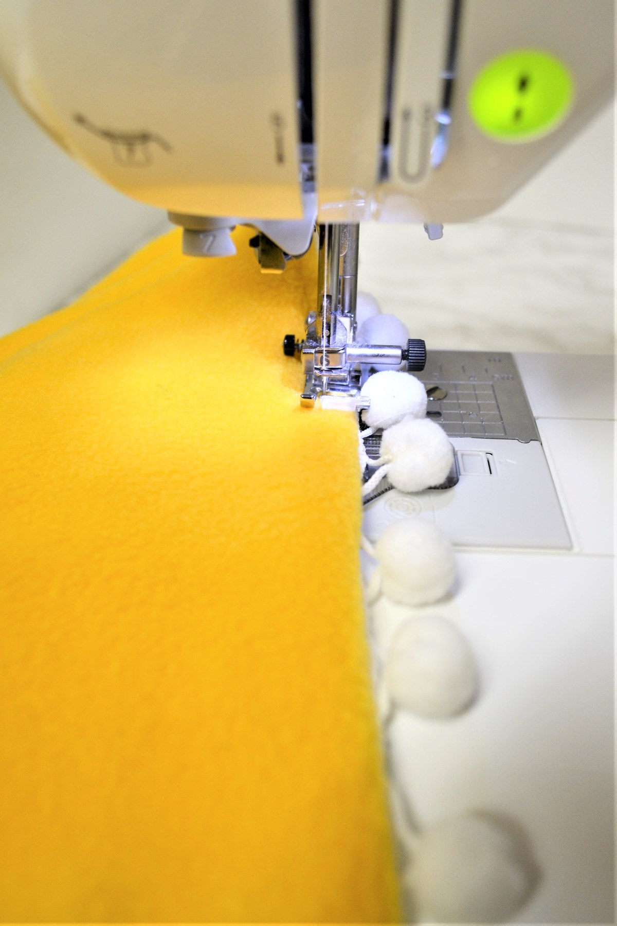 How to Add Pompom Trim to a Quilt - top stitch