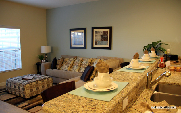 The kitchen and living room area at Paradise palms