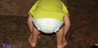 Super Cute Kid Wearing Huggies Diapers