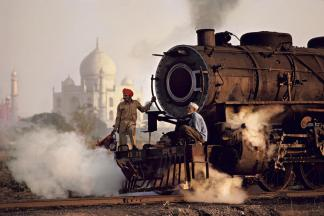 Steve McCurry,INDIA. Uttar Pradesh. Agra. 1983. Steam Train with Taj Mahal in the background.