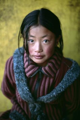 Steve McCurry,TIBET. Shigatse. 2001. Girl in a new Chinese coat.