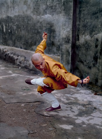 Steve McCurry,Shaolin Monastery; Hunan Province; China; 08/2004; CHINA-10121NF. A man balances himself. Retouched_Ashley Crabill 06/11/2013