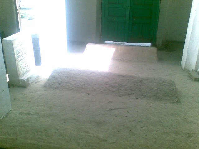 The blessed tomb of the venerable master Shaykh Fazal Ali Qureshi Naqshbandi Mujaddidi. The grave lies inside the room constructed by the Shaykh himself to hold his grave. The grave itself lies uncemented and without cover, as some of the family members of the Shaykh follow an extremist version of Sufism and have not allowed anyone to take proper care of this holy place.