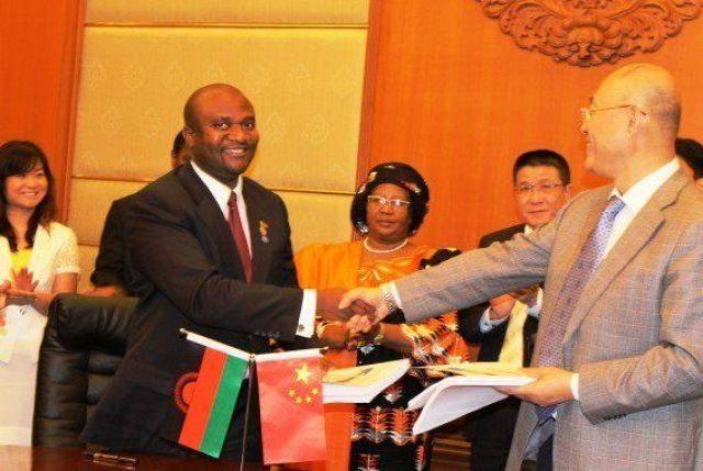 Then Malawi Energy Minister Ibrahim Matola sealing the 300 Megawatt Kam'mwamba Coal Fired Power Plant deal