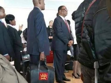 Peter Mutharika queues for plane