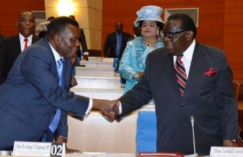 Chaponda (L) can smile together with Finance Minister Goodall Gondwe.