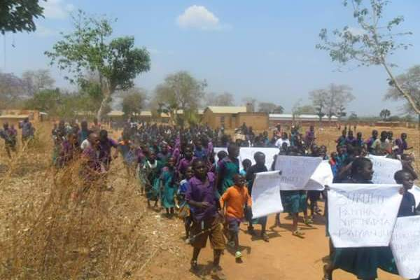 pupils at mbawa school march