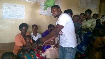 One of the students giving a patient the items.