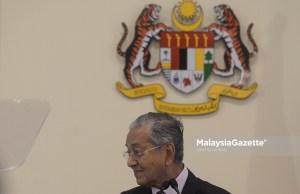 eaksi Perdana Menteri, Tun Dr. Mahathir Mohamad semasa sidang media pada Majlis Pelancaran myPortfolio Panduan Kerja Sektor Awam di Bangunan Perdana Putra, Putrajaya. foto SYAFIQ AMBAK, 14 MEI 2019