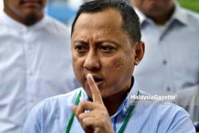 Timbalan Pengerusi Gerakan Pembela Ummah (UMMAH), Kamaruzaman Mohamad bercakap kepada media selepas membuat laporan polis terhadap Peguam Negara, Tommy Thomas di Ibu Pejabat Polis Dang Wangi, Kuala Lumpur. foto FAREEZ FADZIL, 30 MEI 2019