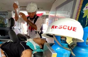 The wounded man is treated in an ambulance in Yangon's Hledan township. PIX: BBC BURMESE