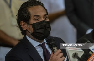 Khairy Jamaluddin Abu Bakar Covid-19 vaccine National Covid-19 Immunisation Prorgamme registration Undi 18 delay EC Election Commission