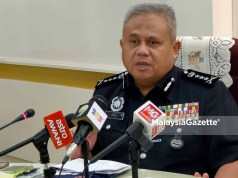 Minister of Plantation Industries and Commodities (MPIC), Datuk Dr Mohd Khairuddin Aman Razali and a woman in Perasing, Terengganu arrest police