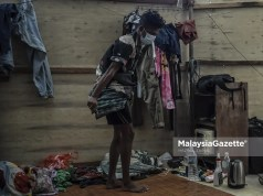 A foreign worker the workers dorm, at a construction site in Kuala Lumpur. PIX: HAZROL ZAINAL / MalaysiaGazette / 19 JUNE 2021. workers dormitory unfit for human Jalan Stonor