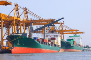 35985294-commercial-ship-with-container-on-shipping-port-for-import-export-and-logistic-transportation
