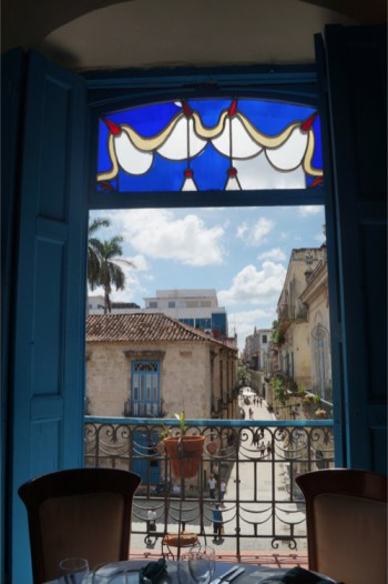 Looking outside a window at one of Havana's many cafes.