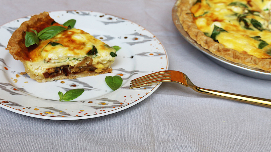 quiche with carmelized onions, mushrooms, spinach + feta cheese