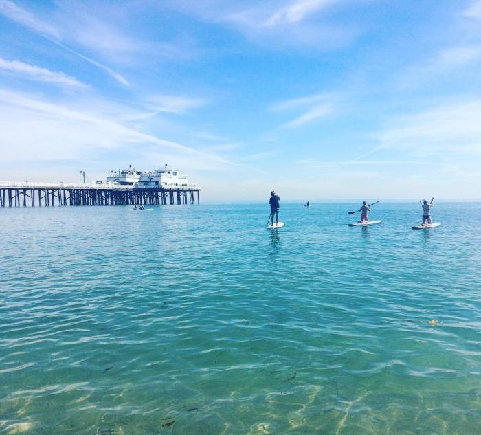 Stand Up Paddle Boarding at Surfrider Beach by the Malibu Pier