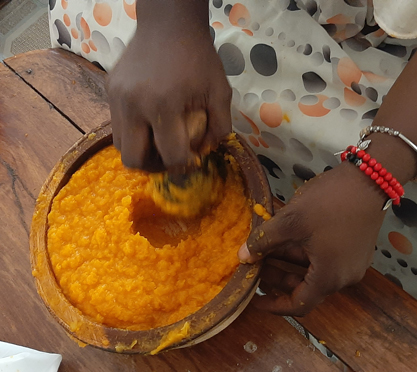 Mashing pumpkin and carrot