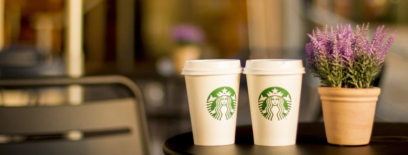 two starbucks coffee cups