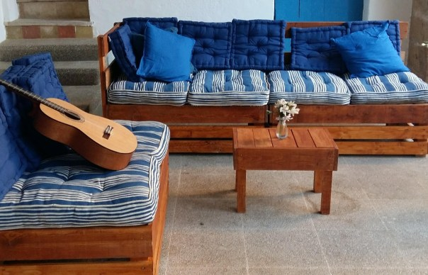 Pallet chillout with striped blue and cream cushions